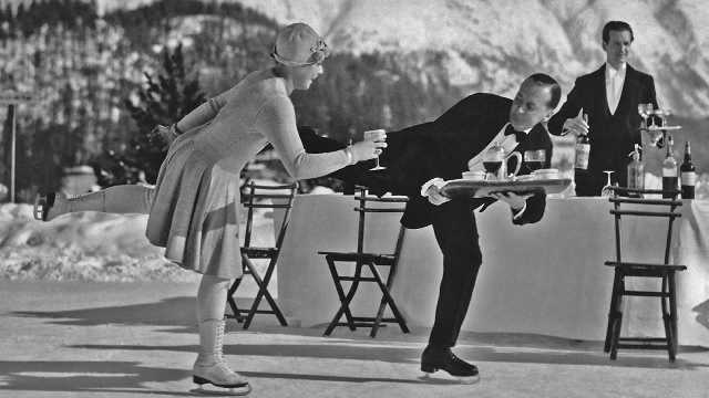 Circa 1925: Skating waiters serve drinks to guests on the ice rink at the Grand Hotel in St Moritz, Switzerland. (G. Riebicke/Archive Photos/Getty Images)